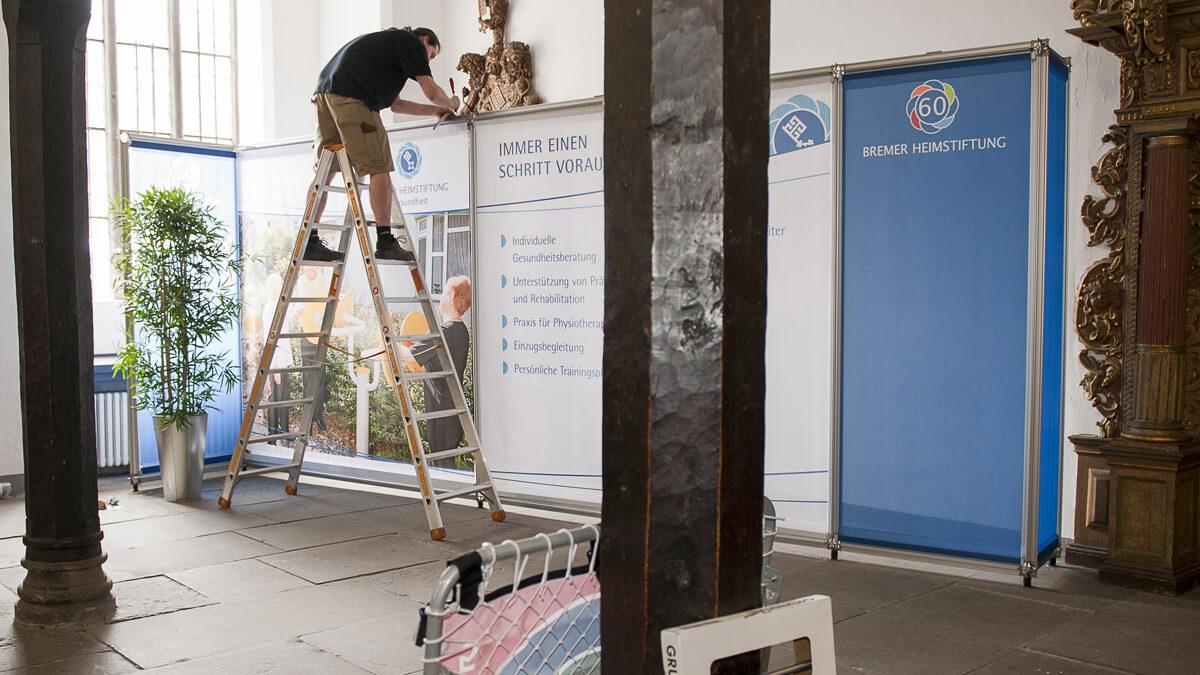 Anka Werbung - Messebau Bremen - Ausstellungen - Montage vor Ort (Bremer Heimstiftung)